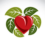 Beautiful red heart surrounded with green spring leaves. Care ab Stock Image