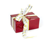 Beautiful red holographic gift box with bows Stock Images
