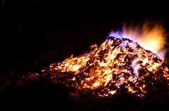 Beautiful red hot glowing ember pile with colorful flames Royalty Free Stock Photos
