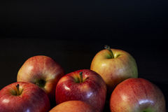 A beautiful red juicy apple. On a black background. One apple in the photo. Bright photo. Black. A beautiful red juicy apple. On a black background. One apple in Stock Photo