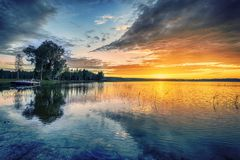 Beautiful red landscape sunset. Beautiful red sunset landscape on lake Stock Photo