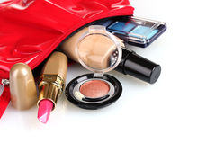 Beautiful red makeup bag and cosmetics Stock Images