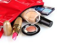 Beautiful red makeup bag and cosmetics Stock Images