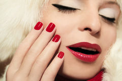 Beautiful red manicure and makeup. Stock Photo