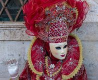 Beautiful red mask and costume at the Venice carnival Royalty Free Stock Photography