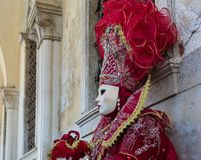 Beautiful red mask and costume at the Venice carnival Royalty Free Stock Photos