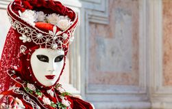Beautiful red mask and costume at the Venice carnival Stock Image