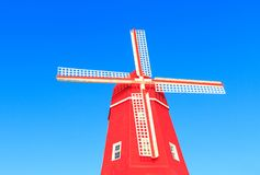 Beautiful red mill against blue sky royalty free stock photo