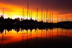 Beautiful red and orange sunset in a Florida marina stock photography