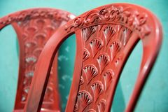 Red plastic chairs isolated object photo. Beautiful red plastic chairs isolated object unique royalty free image royalty free stock image