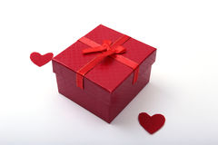 Beautiful red present, gift box with red bow and heart on white backgound. Stock Photography