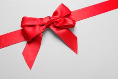 Beautiful red ribbon with bow. On light background stock images