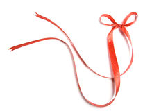 Beautiful red ribbon and bow, good for design. Isolated on a white background Royalty Free Stock Image