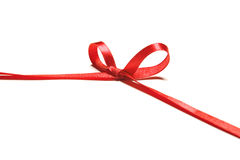 Beautiful red ribbon and bow, good for design. Isolated on a white background Royalty Free Stock Photo