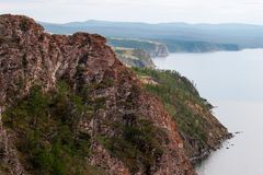 Beautiful red rocks on the shore of Lake Baikal on Olkhon Island. royalty free stock image