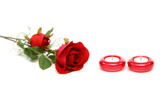 Beautiful red rose and candles Royalty Free Stock Photography