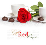 Beautiful red rose and cup of hot tea with chocolate Royalty Free Stock Image
