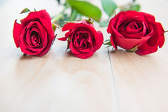 Beautiful Red rose flower on wooden background . Beautiful Red rose flower on wooden background Stock Photo
