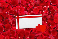 Beautiful red rose petals background and envelop (letter) with r Stock Photography