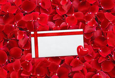 Beautiful red rose petals background and envelop (letter) Royalty Free Stock Photo