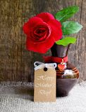 Beautiful red rose in a vintage vase with Happy Mother´s Day tag card on wooden background.Mothers Day festive concept. royalty free stock photo