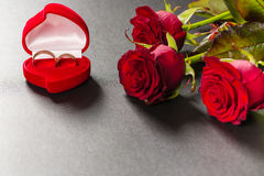 Beautiful red roses bouquet on a black background. Royalty Free Stock Images