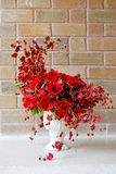 Beautiful red roses bunch in white vase Royalty Free Stock Photo