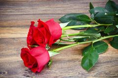 Beautiful Red Roses Flower on Wood Royalty Free Stock Photography