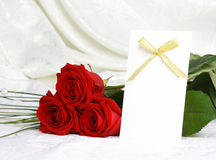 Beautiful red roses and invitation card Stock Photos