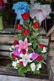 Beautiful red roses and orchids. Royalty Free Stock Photos