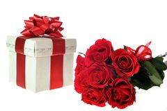 Beautiful red roses and present Stock Images