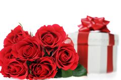 Beautiful red roses and present Royalty Free Stock Photos