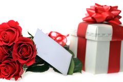 Beautiful red roses and present Stock Photography