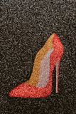 Beautiful red sexy shoe with high heels on black background. Beautiful red sexy high-end shoe with high heels on black background. Vertical illustration of women Stock Photography