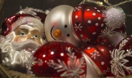 Beautiful red shiny santa claus and snowman christmas tree decor Royalty Free Stock Photo