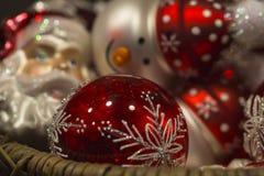 Beautiful red shiny santa claus and snowman christmas tree decor Stock Photos