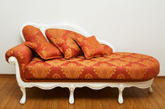 Beautiful red sofa stock images