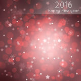 Beautiful red star and snowflake Happy new year. Beautiful red colored blurry bokeh 2016 Happy new year greeting card with blurred star shapes and snowflakes Royalty Free Stock Photography
