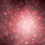Beautiful red star and snowflake shapes bokeh background Royalty Free Stock Images