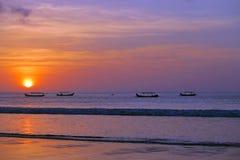 Beautiful red sun sunset with fisherman`s boats silhouettes, Kuta beach, Bali Stock Image