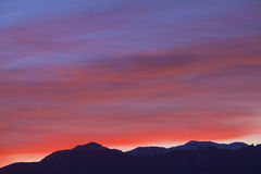 Beautiful red sunrise in the mountains Stock Images