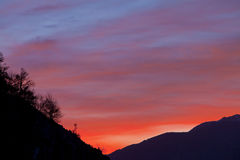 Beautiful red sunrise in the mountains Stock Image