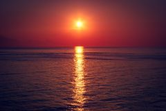 Beautiful red sunset over dark sea. Summer background. royalty free stock photo