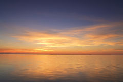 Beautiful red sunset over the ocean Stock Photos