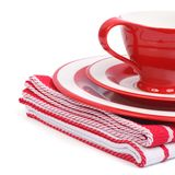 Beautiful red tea cup and saucer on a striped napkin folded Stock Photos
