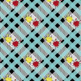 Beautiful red and tellow flowers pattern on black and blue tartan plaid background eps10 royalty free illustration