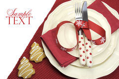 Beautiful red theme festive Christmas dining table place setting. With Happy Holiday ornaments and decorations with copy space for your text here royalty free stock photos