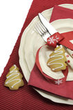Beautiful red theme festive Christmas dining table place setting with Happy Holiday ornaments. And decorations with copy space for your text here stock image