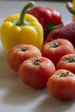 Beautiful red tomatoes on the kitchen counter with other vegetab. Les Stock Photos