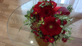 Beautiful red wedding bouquet on the transparent table glass stock video